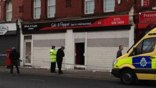 A restaurant taped off by police
