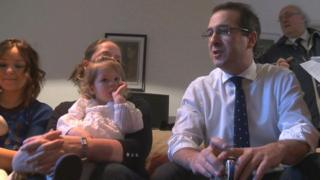 Owen Smith with mothers and children