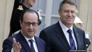 French President Francois Hollande (l) greets Romanian President Klaus Iohannis (r) as he arrives at Elysee Palace, in Paris, 10 February 2015