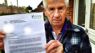 Mr Goleby holding the letter