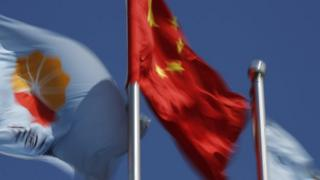 The flag of the Chinese energy company PetroChina flies next to China's national flag