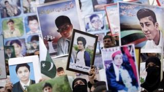 Relatives of killed students hold photos depicting the victims during a protest demanding that the culprits of the attack be brought to justice, in Peshawar, Pakistan, 7 February 2015