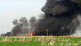 Smoke billows near Al-Assal village, some 25 km West of the northern city of Kirkuk, on February 1, 2015, a day after Peshmerga forces and police retook the area from Islamic State (IS) group