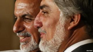 Afghan presidential candidates Ashraf Ghani Ahmadzai and Abdullah Abdullah hugging each other during a news conference in Kabul 15 January 2015