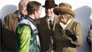 Duchess of Cornwall with winning jockey Lance Bombardier Jody Sole after Cowards Close won the Royal Artillery Gold Cup Day at Sandown