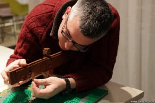 Artist Warren Elsmore puts the final touches on the Angel of the North