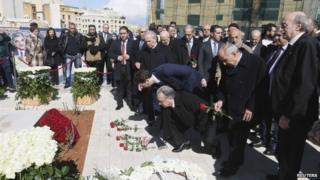 "Lebanon""s Druze leader Walid Jumblatt (R) and members of his parliamentary bloc lay flowers at the grave of former Prime Minister Rafik al-Hariri, to mark the 10th anniversary of al-Hariri""s assassination, in downtown Beirut, February 14, 2015"