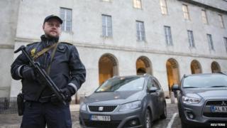 Armed officer outside Copenhagen police headquarters. 15 Feb 2015