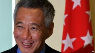"""In this file picture taken on April 7, 2014, Singapore Prime Minister Lee Hsien Loong smiles as he speaks during a joint press conference at the prime minister""""s office in Malaysia""""s administrative capital in Putrajaya"""