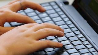 Hands on a computer keyboard
