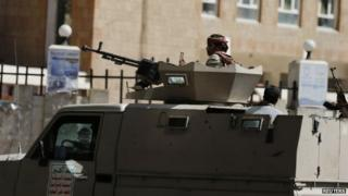 Houthi fighters ride a military truck on a street near the Saudi and UAE embassies in Sanaa