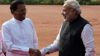 Sri Lankan President Maithripala Sirisena (L) shakes hands with Indian Prime Minister Narendra Modi during the welcome ceremony at the Presidential Palace in Delhi on February 16, 2015.