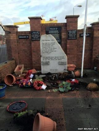 Flower pots were broken and a union flag was ripped down at the memorial on Belfast's Newtownards Road on Sunday night