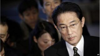 Japanese Foreign Minister Fumio Kishida, right, listens to questions from journalists on Japanese journalist Kenji Goto taken hostage by the Islamic State group, at the prime minister's official residence in Tokyo, Friday, 30 January 2015
