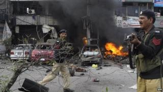 Pakistani policemen arrive at the site of a bomb explosion in Lahore on 17 February 2015.