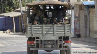 Soldiers pass along a deserted road at self-administered Kokang capital Laukkai, on 7 February 2015