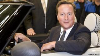 Prime Minister David Cameron drives the two millionth MINI off the production line, after ten years of production, at the MINI Plant Oxford on August 31, 2011 in Oxford, England.