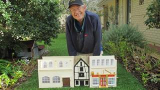 Chris Beckett with his Norwich banks model
