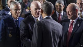 Acting director of the Secret Service Joseph Clancy shakes hands with President Barack Obama at Department of Homeland Security after Obama delivered remarks on his FY2016 budget proposal, 2 February 2015