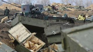 Ukrainian armed forces with shell boxes in the foreground in Donetsk region 20/02/2015