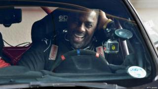Idris Elba in rally car