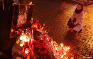 A woman kneels and weeps at a memorial in Kiev, Ukraine - 20 February 2015