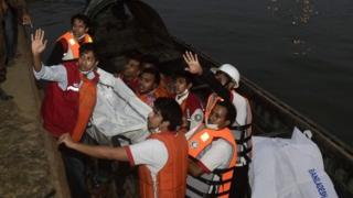 Bangladeshi rescue workers recover the body of a victim after a ferry accident at Paturia some km east of Dhaka on February 22, 2015