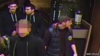 Three men in Canterbury McDonalds
