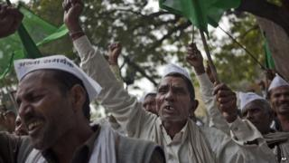 Indian farmers shout slogans against the government's proposed move to ease rules for acquiring land to facilitate infrastructure projects in New Delhi, India, Monday, Feb. 23, 2015.