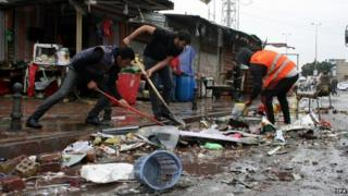 Iraqis remove debris after a bomb attack at new Baghdad district in eastern Baghdad, Iraq, 07 February 2015