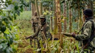 Democratic Republic of Congo regular army soldiers stand guard in the Nakabumbi area of Kimbumba, 20kms from Goma, near the border with Rwanda, on June 14, 201