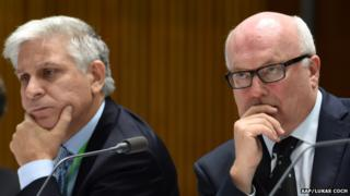 Attorney-General Secretary Chris Moraitis (left) and Attorney-General George Brandis react during a Senate Estimates hearing at Parliament House in Canberra, Tuesday, 24 February 2015.