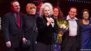 Carole King (centre) on stage with Barry Mann, Cynthia Weil and cast members of Beautiful