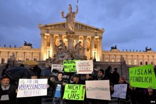 "Protesters hold banners during the demonstration under the slogan ""New Islam Law? Not with us!"" in front of the parliament building in Vienna, Austria, 24 February 2015"