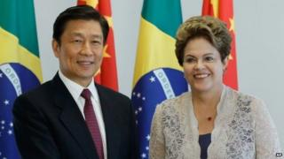 China's Vice President Li Yuanchao shakes hands with President Dilma Rousseff in Brasilia on 2 January, 2015.