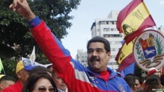 """Venezuela""""s President Nicolas Maduro (R) greets supporters during a rally to commemorate the 26th anniversary of the social uprising known as """"Caracazo"""", which Venezuela""""s late President Hugo Chavez said marked the start of his revolution, in this Caracas"""