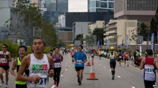 """Competitors run in Hong Kong""""s first inner city ultra marathon on March 1, 2015"""