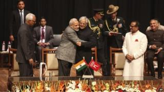 PM Narendra Modi, centre left, greets Peoples Democratic Party Mufti Mohammed Sayeed after the later was sworn in as the chief minister of Jammu and Kashmir state on Sunday, March 1, 2015.