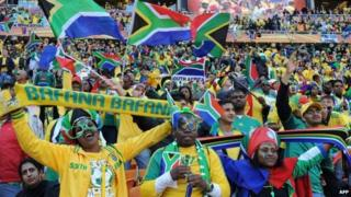 South African supporters cheer before the opening match of the 2010 World Cup at Soccer City stadium in Soweto. 11 June 2010