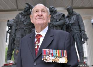 Les Munro wearing his decorations and medals, standing in front of the Bomber Command Memorial in Green Park, London, in 2013