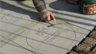 Laying the memorial slabs