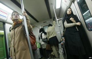 Women standing on metro
