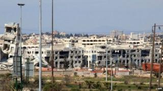 Photo taken on 5 March 2015 shows damaged Air Force Intelligence headquarters in Aleppo