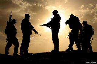 17 May 2006, British soldiers silhouetted against the sky in Helmand province, Afghanistan