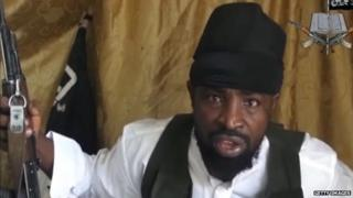 A screengrab taken on 24 March, 2014 from a video of a man claiming to be the leader of Boko Haram, Abubakar Shekau