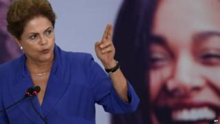 Brazil's President Dilma Rousseff speaks during a signing ceremony for a harsher law against femicide, at the Planalto Presidential Palace in Brasilia, Brazil, Monday, March 9, 2015.
