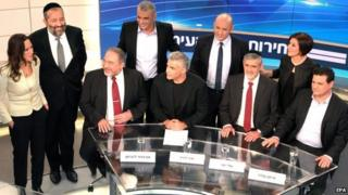 """Israeli political party leaders with the an Israeli Channel 2 host (L) posing for a group portrait prior to the taping of the """"political duel"""" or election television debate in the Neve Ilan TV studio"""