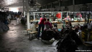 Workers in a small, unmarked subcontractor factory in Cambodia