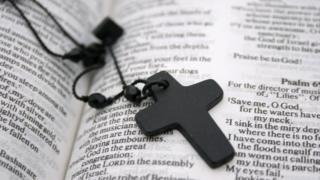 A cross on a bible