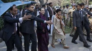 Congress party President Sonia Gandhi returns after marching to the residence of former Indian prime minister Manmohan Singh to express her solidarity after Singh was accused of criminal conspiracy and breach of trust for his alleged role in a multibillion dollar scandal over the sale of coal fields, in New Delhi, India, Thursday, March 12, 2015